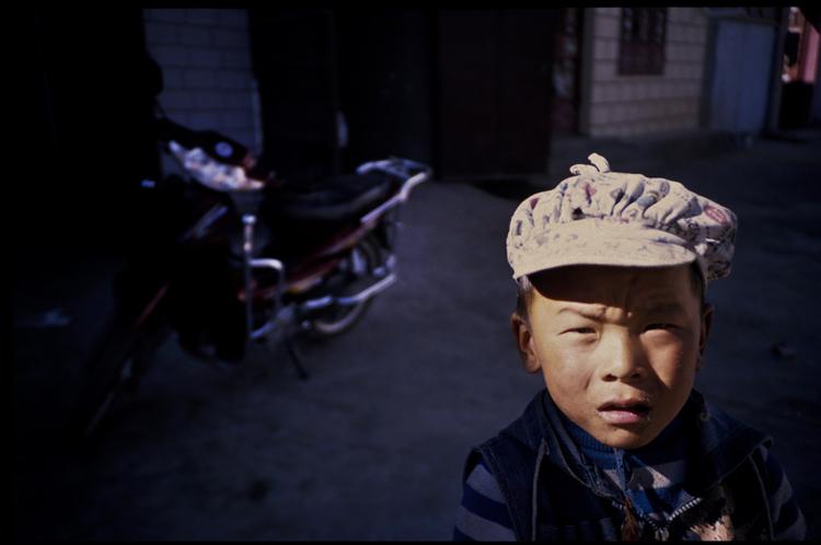Boy with motorbike